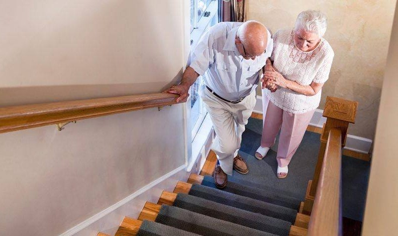 old age couple moving upstairs